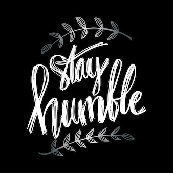 Continue humilde. citação de vida com caligrafia de letras de mão.