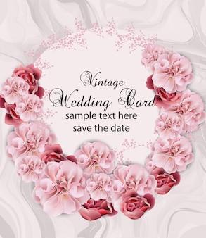 Convite de casamento com guirlanda floral sobre textura de mármore