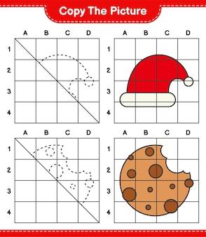Copie a imagem do jogo de planilha educacional do chapéu do papai noel e cookies usando linhas de grade