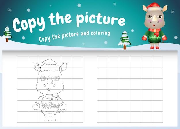 Copie o jogo de imagem para crianças e a página para colorir com um rinoceronte bonito usando uma fantasia de natal