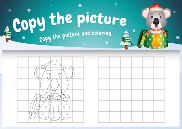 Copie o jogo de imagens para crianças e a página para colorir com um coala fofo usando uma fantasia de natal