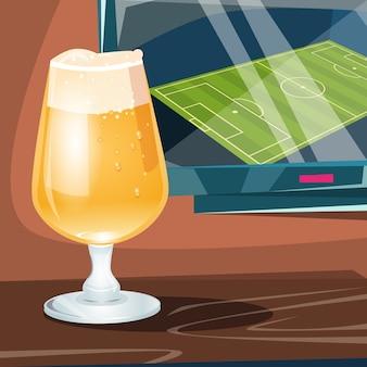 Copo de cerveja sobre televisor