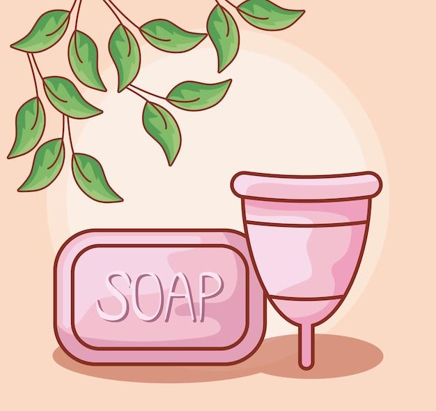 Copo menstrual com sabão em barra e folhas