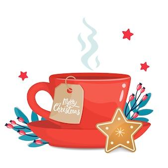 Copo vermelho com biscoito de natal em forma de estrela e natal