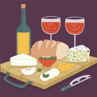 Copos de vinho e lanche de tábua de queijo
