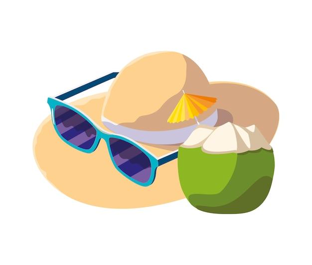 Coquetel de coco fresco com chapéu de palha e óculos de sol