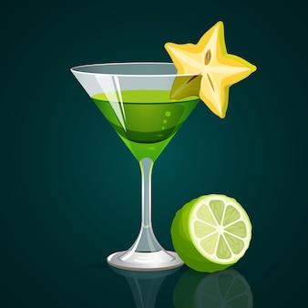 Coquetel verde em copo de forma triangular e carambola na borda com parte de limão no escuro.