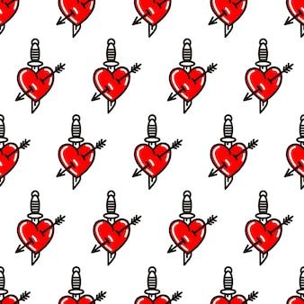 Coração com punhal no estilo do padrão sem emenda de tatuagem da velha escola