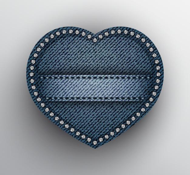 Coração de denim azul com faixa costurada e lantejoulas prateadas na borda.