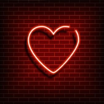 Coração de néon. um sinal vermelho brilhante em uma parede de tijolos