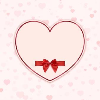 Coração de papel com fita vermelha e um laço.