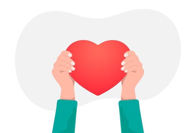 Coração nas mãos isolado no branco