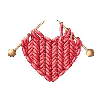 Coração vermelho de malha com agulhas de tricô