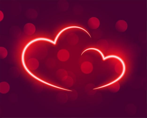 Corações brilhantes de néon em bokeh de fundo