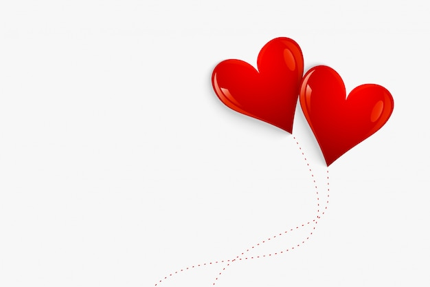Corações de balão vermelho isolados no fundo branco