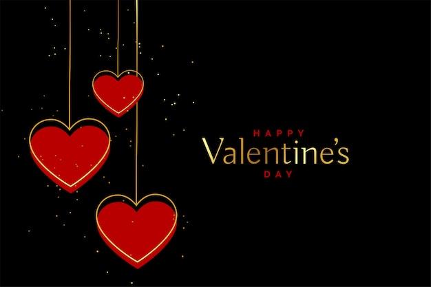 Corações de dia dos namorados de vermelho e dourado em fundo preto