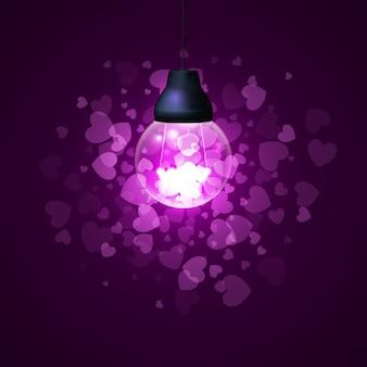 Corações de doces em torno de uma lâmpada brilhante em um rosa com lareira