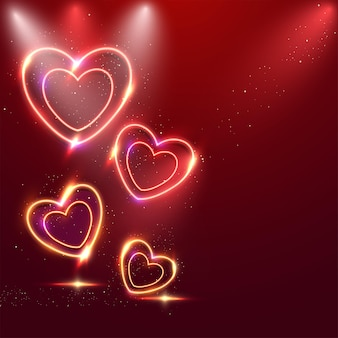 Corações de efeito de néon com partículas douradas sobre fundo vermelho.