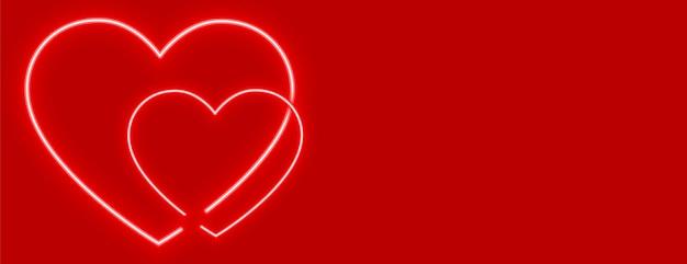 Corações de néon elegantes com design de fundo vermelho
