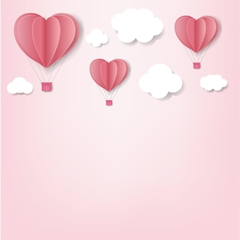 Corações de papel com fundo rosa nuvem