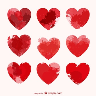 Corações do vetor com manchas de tinta