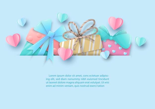 Corações em cores doces com caixa de presente de dia dos namorados em corte de papel