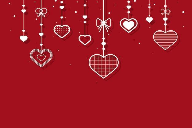 Corações pendurados em fundo vermelho