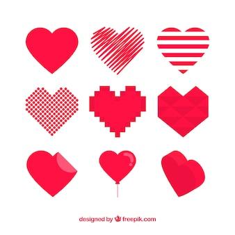 Corações vermelhos ajustaram-se de diferentes formas