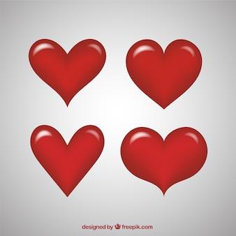 Corações vermelhos fantásticos com formas diferentes