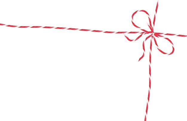 Corda branca vermelha com laço, decoração de embrulho de natal, corda de pacote isolada.