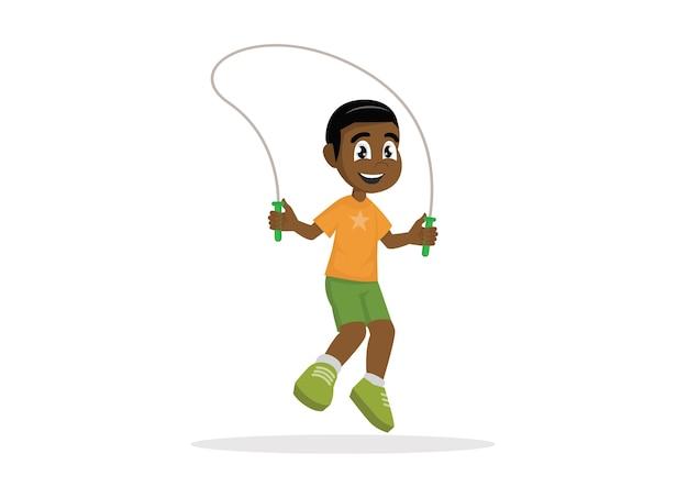 Corda de salto do menino africano.