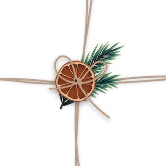 Cordas de linho realistas com galhos de pinheiro e uma fatia de laranja seca