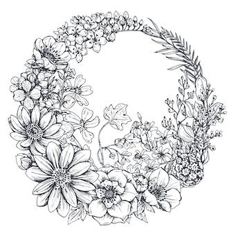 Coroa de flores com flores desenhadas mão, folhas, ramos no estilo de desenho. Vetor Premium
