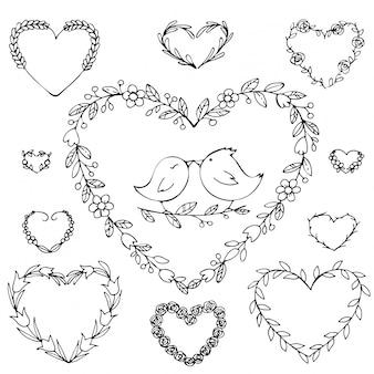 Coroa desenhada de mão em forma de coração com flores.