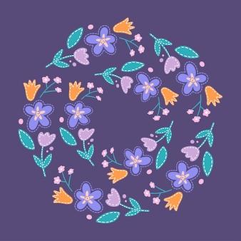 Coroa redonda de flores diferentes