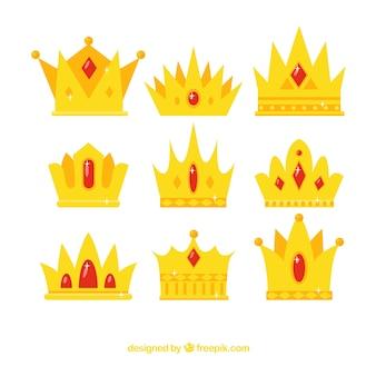 Coroas fantásticas com pedras preciosas vermelhas em design plano