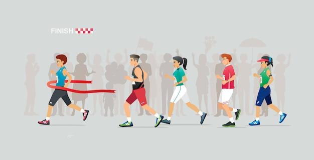 Corredoras femininas correm para a linha de chegada na maratona.