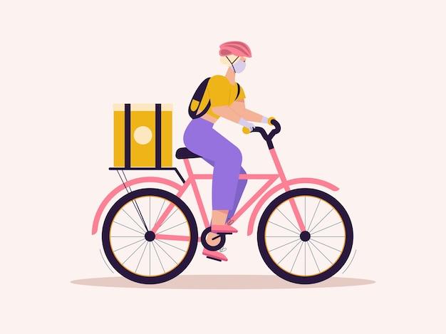 Correio de mulher com pacote de bicicleta. jovem com máscara protetora e luvas. entrega rápida sem contato de alimentos ou compras, compras online
