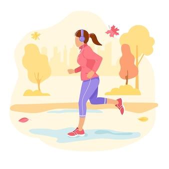 Correndo. outono. uma garota com fones de ouvido em uma corrida.