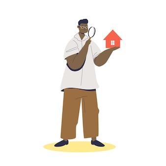 Corretor de imóveis segurando casa na mão