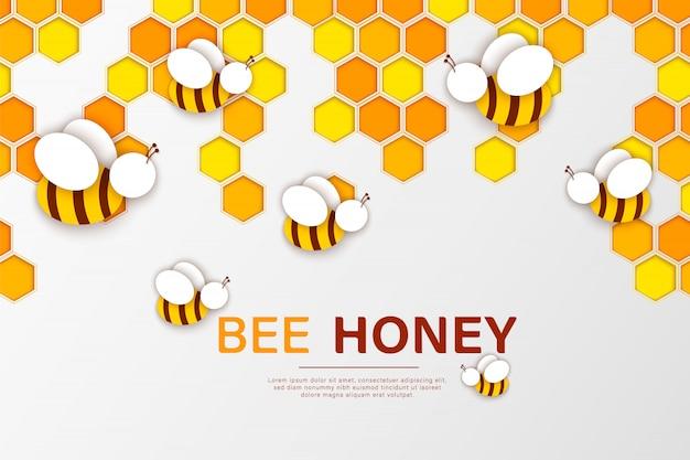 Corte de papel com abelhas e favos de mel.