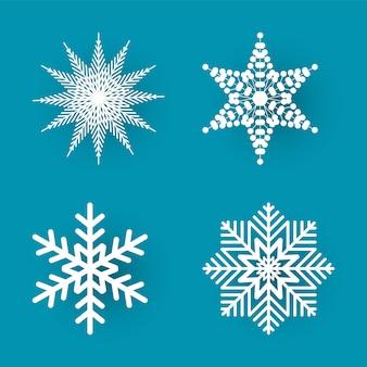 Corte de papel de natal quatro flocos de neve brancos
