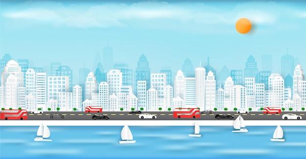 Corte de papel de vetor e na cidade grande, com edifícios e casas.