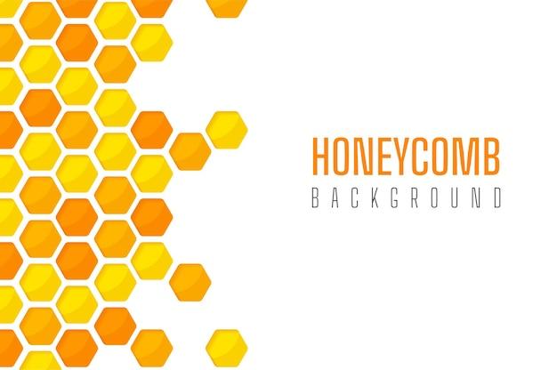 Corte de papel hexagonal amarelo dourado com padrão de favo de mel