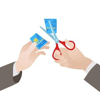 Corte do cartão de crédito azul ao meio por uma tesoura