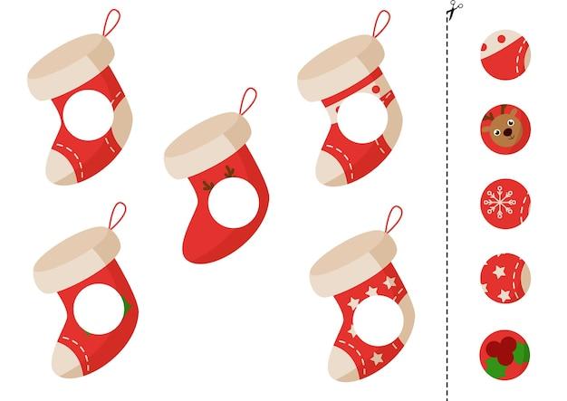 Corte e cole partes de meias de natal. jogo educativo para crianças.