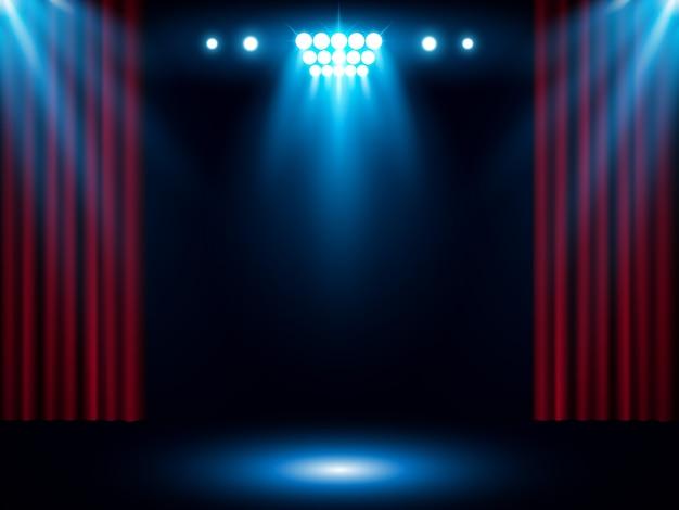 Cortina de palco vermelho com holofotes azul