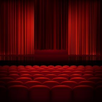 Cortinas abertas de teatro vermelho.