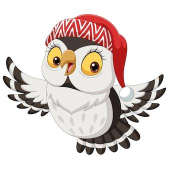 Coruja de desenho animado usando um chapéu de natal