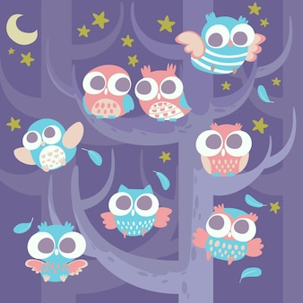 Corujas em uma árvore no fundo da noite